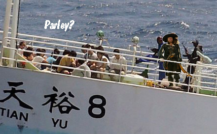 <em>Somali pirates holding crewmembers of the Chinese fishing vessel FV Tian Yu 8</em>