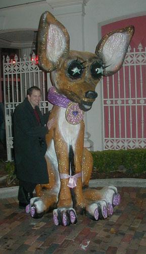 <em>A.I. posing with the styrofoam dog thing</em>