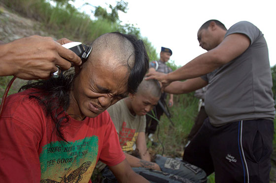 Punks in forced head shaving