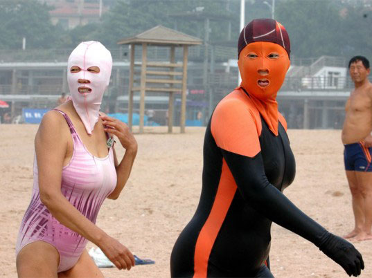 Chinese women wearing face-kinis