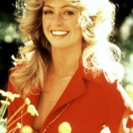 A smiling Farrah Fawcett in red