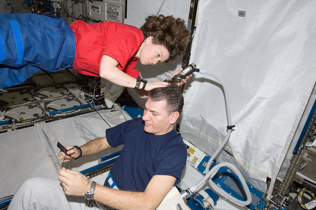 1200px-Haircut_in_ISS_ISS026-E-017736_(15_Jan._2011)