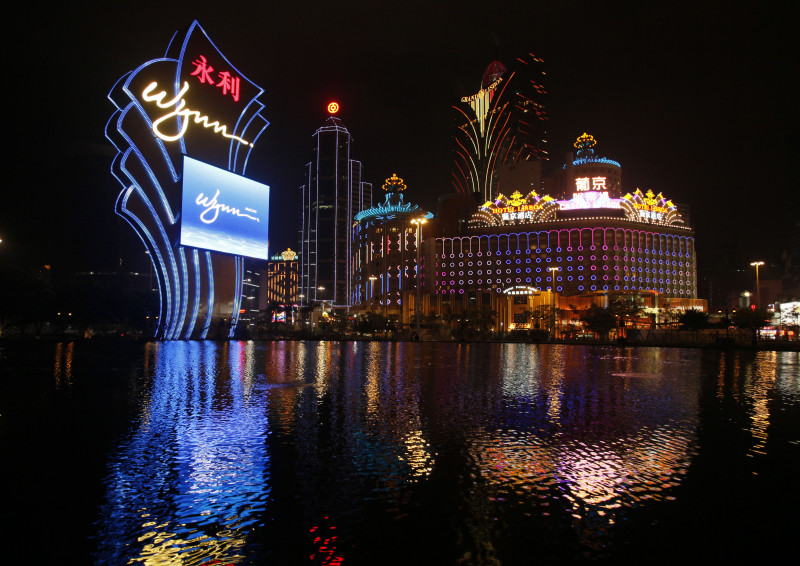 "FILE - In this Thursday April 22, 2010 file photo, the Wynn Macau is lit up. The Chinese arm of Wynn Resorts Ltd. said it received approval on Wednesday, May 2, 2012 for a new casino in the Cotai district of Macau, the world's most lucrative gambling market. Wynn Resorts founder, chairman and CEO Steve Wynn said the Cotai development is the ""single most important project"" in his company's history. (AP Photo/Kin Cheung, File)"