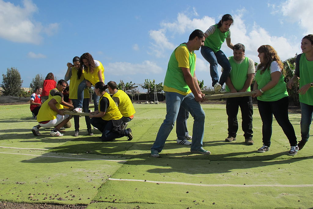 Team building exercises bring out the best in your employees ... photo by CC user Ivanojedaq on wikimedia commons