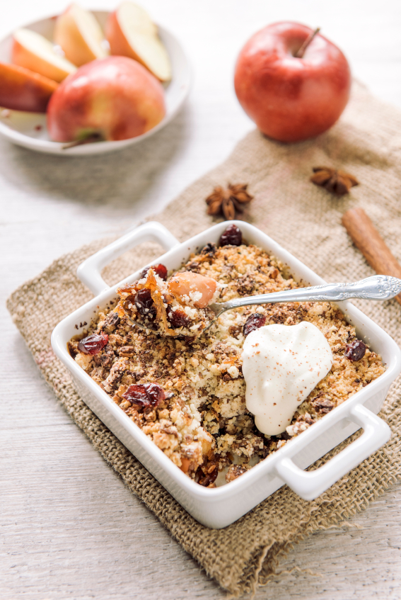 Popular traditional apple crumble cake in bowl,selective focus
